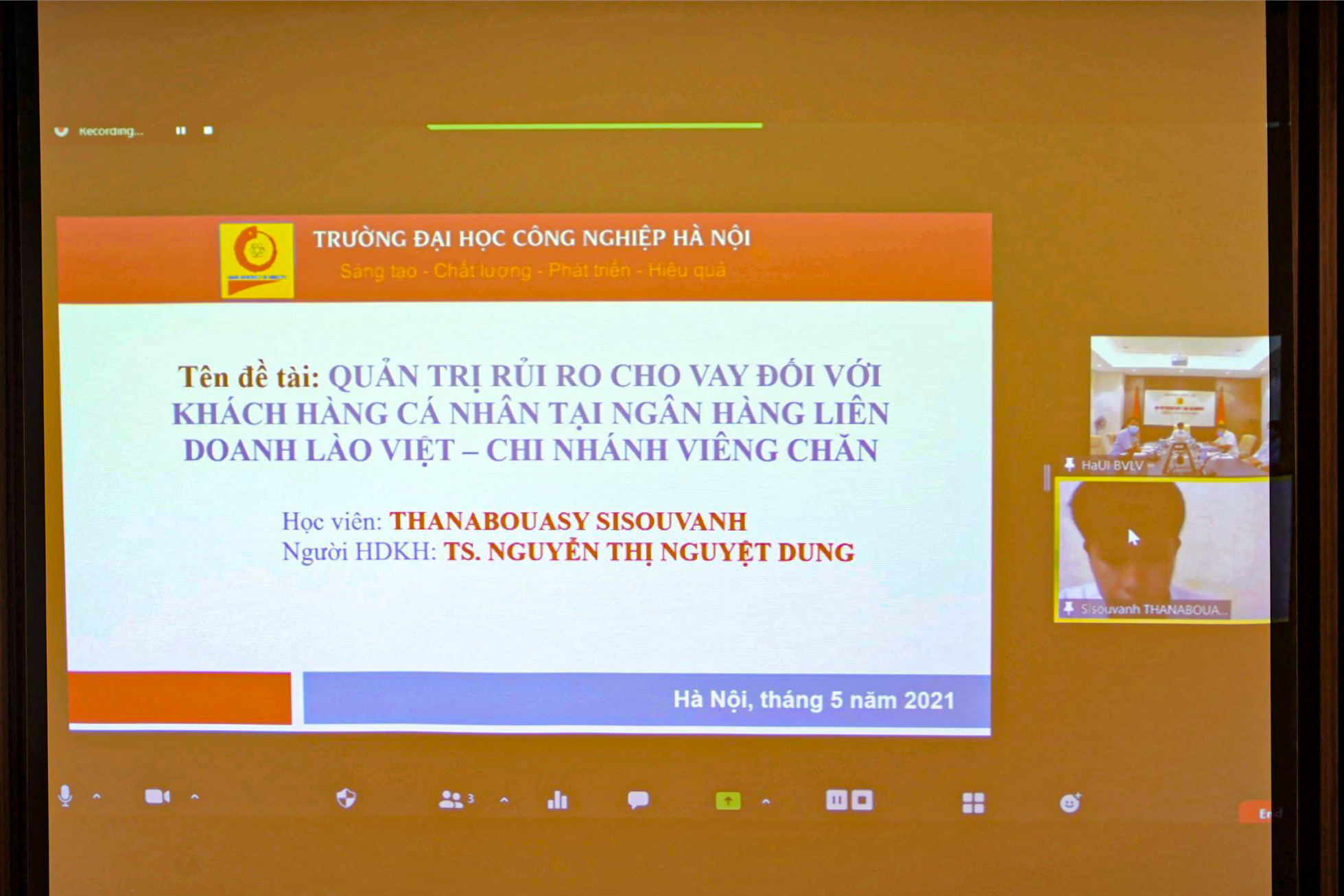 HaUI organizes an online Masters Thesis Defense for Laos students